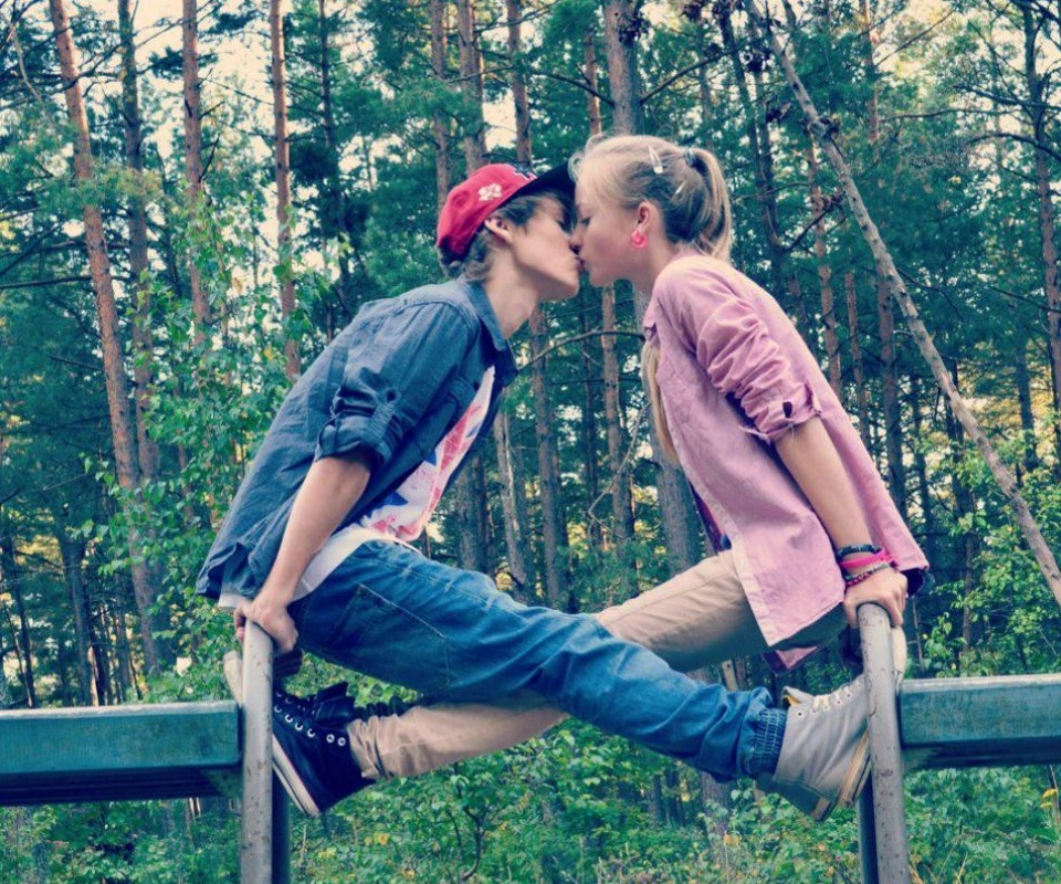 Two young girls kiss